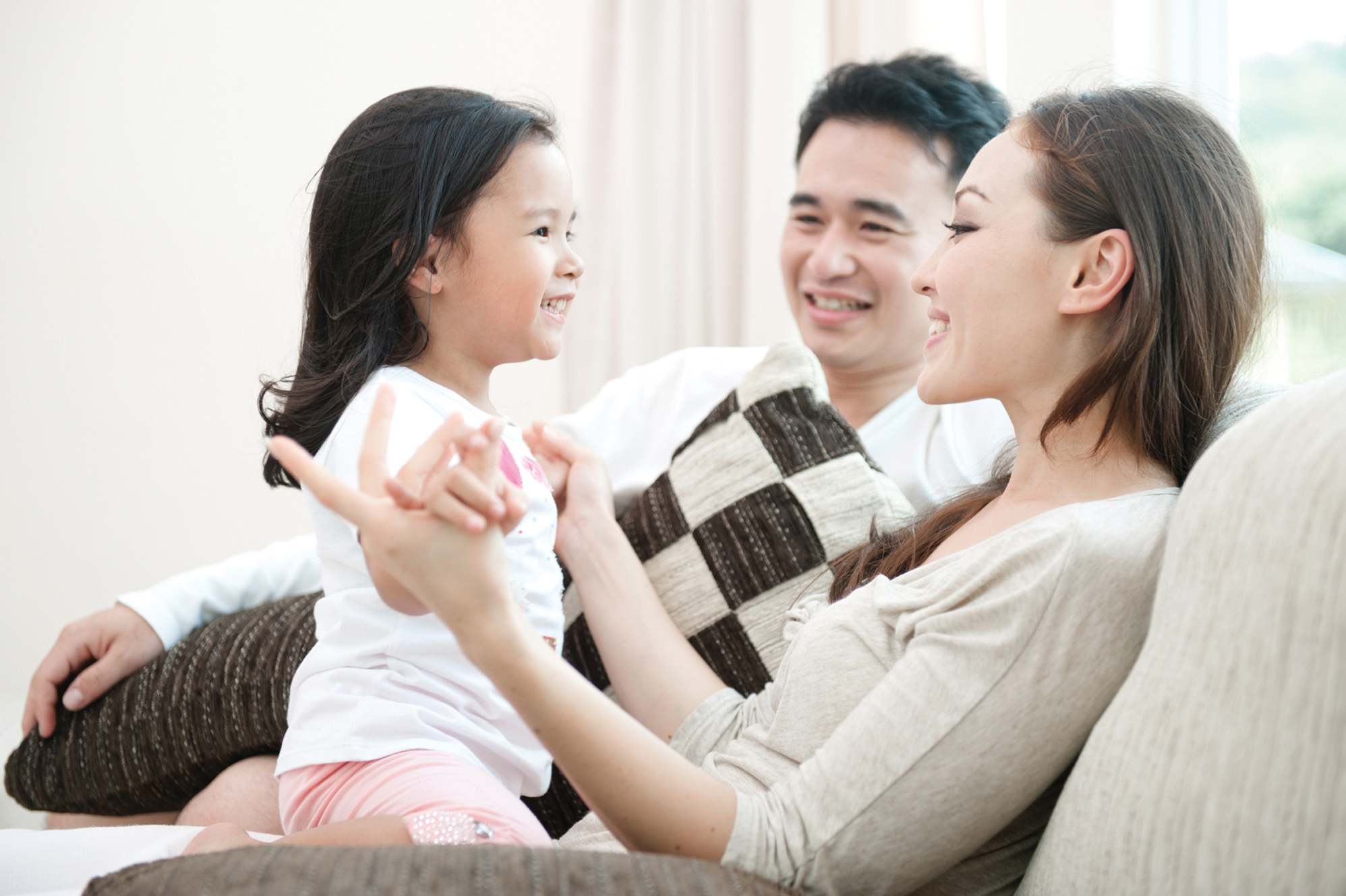 Happy Asian Family Playing with daughter in the living room